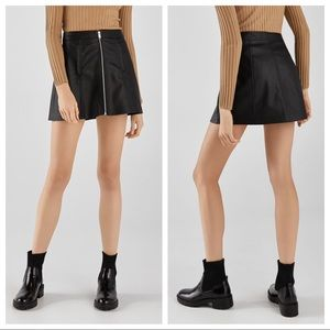 NWT. Bershka Zipped faux leather skirt. Size M.